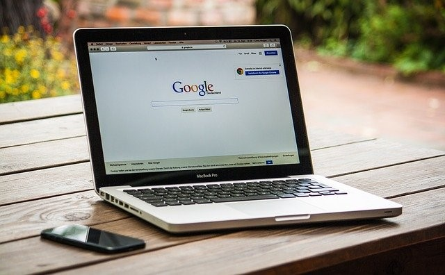 A laptop with the Google homepage.