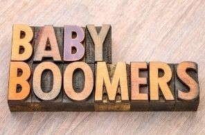 Baby boomers written out in block letters on a wooden background